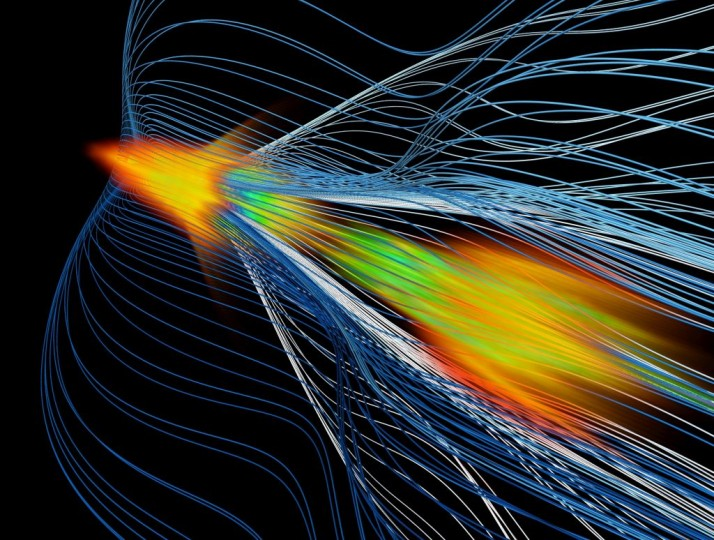 Simulation of high-energy positron acceleration in an ionized gas, or plasma – a new method that could help power next-generation particle colliders. The image shows the formation of a high-density plasma (green/orange color) around a positron beam moving from the bottom right to the top left. Plasma electrons pass by the positron beam on wave-like trajectories (lines). (W. An/UCLA)