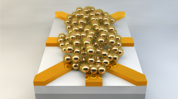 Artificial evolution and electrical current (applied to the yellow electrodes) can turn this disordered network of nanoparticles into a functioning electrical circuit. Image courtesy of Twente University.