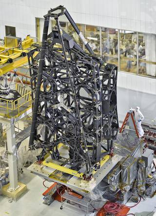 The flight structure of NASA's James Webb Space Telescope was standing tall in the cleanroom at NASA's Goddard Space Flight Center in Greenbelt, Maryland. Credits: NASA/C. Gunn