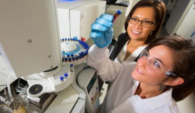 UB chemistry professor Diana Aga, left, and chemistry doctoral candidate Deena Butryn examine blood and breast milk samples using the one-shot method. Image credit: Douglas Levere.