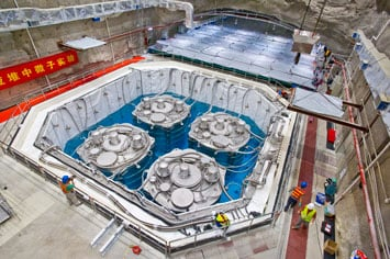 Bird's-eye view of the underground Daya Bay Far Hall during installation. The four antineutrino detectors are immersed in a large pool filled with ultra pure water as a cosmic muon veto system. (Photo by Roy Kaltschmidt, Berkeley Lab)