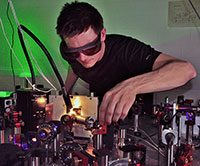 Dominik Differt measuring the scattering of light in a rough absorber film. Image credit: Bielefeld University