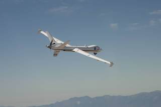 The Ikhana UAS soars over the Mojave Desert during a flight from NASA Armstrong Flight Research Center, Edwards, California. Credits: NASA Photo / Carla Thomas