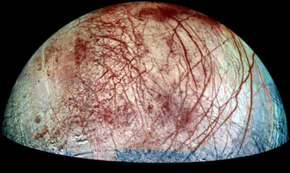 Europa, a moon of Jupiter, appears as a thick crescent in this enhanced-color image from NASA's Galileo spacecraft. Credit: NASA