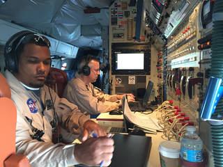 Mission managers Matt Berry (l) and Tim Moes (r) at the operations console aboard NASA's DC-8 research aircraft. Credits: NASA / Peter Merlin