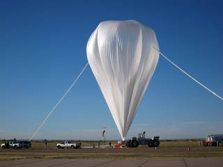 The 2014 test of the E-MIST system is prepared for flight on August 24, 2014 at NASA's Columbia Scientific Balloon Facility in Fort Sumner, New Mexico. Credits: NASA / David J. Smith