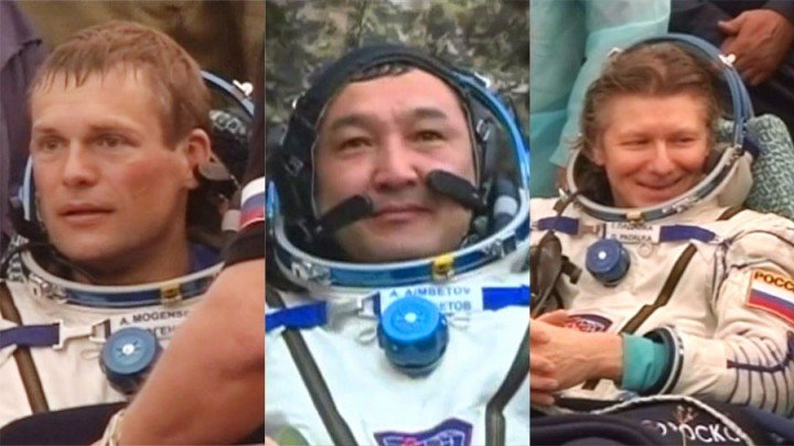 Soyuz TMA-16M crew members (from left) Andreas Mogensen, Aidyn Aimbetov and Gennady Padalka rest outside their spacecraft and are surrounded by support personnel after landing in Kazakhstan. Credit: NASA TV