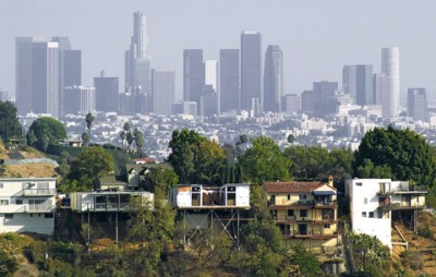Downtown Los Angeles sits in contrast to a low-income neighborhood. The Greater L.A. area has a large number of communities disproportionately affected by environmental health hazards compared with other areas in the state.