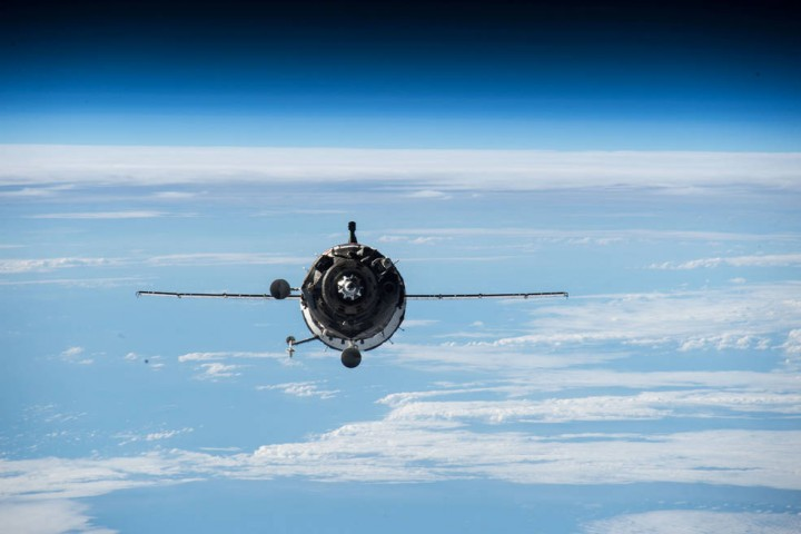 Three International Space Station crew members are set to return aboard the Soyuz TMA-16M spacecraft, which has been docked to the station since March. Credits: NASA