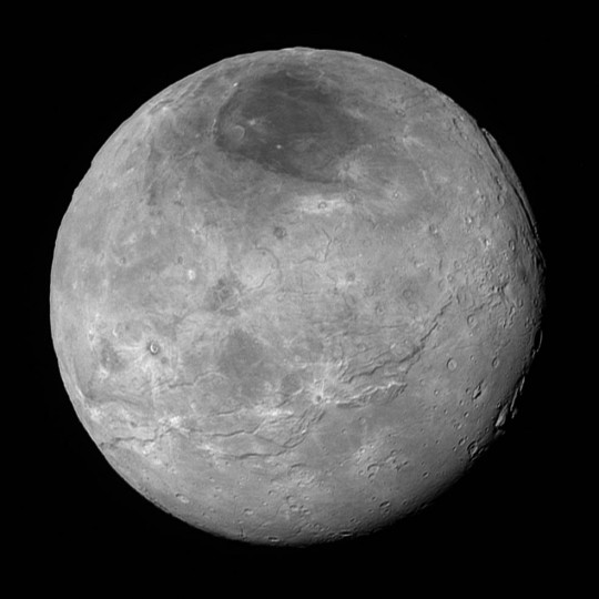 This image of Pluto's largest moon Charon, taken by NASA's New Horizons spacecraft 10 hours before its closest approach to Pluto on July 14, 2015 from a distance of 290,000 miles (470,000 kilometers), is a recently downlinked, much higher quality version of a Charon image released on July 15. Charon, which is 750 miles (1,200 kilometers) in diameter, displays a surprisingly complex geological history, including tectonic fracturing; relatively smooth, fractured plains in the lower right; several enigmatic mountains surrounded by sunken terrain features on the right side; and heavily cratered regions in the center and upper left portion of the disk. There are also complex reflectivity patterns on Charon's surface, including bright and dark crater rays, and the conspicuous dark north polar region at the top of the image. The smallest visible features are 2.9 miles 4.6 kilometers) in size. Credits: NASA/Johns Hopkins University Applied Physics Laboratory/Southwest Research Institute