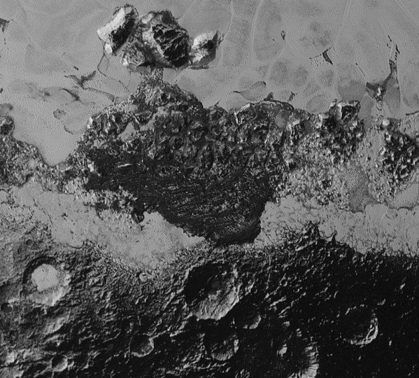 This 220-mile (350-kilometer) wide view of Pluto from NASA's New Horizons spacecraft illustrates the incredible diversity of surface reflectivities and geological landforms on the dwarf planet. The image includes dark, ancient heavily cratered terrain; bright, smooth geologically young terrain; assembled masses of mountains; and an enigmatic field of dark, aligned ridges that resemble dunes; its origin is under debate. The smallest visible features are 0.5 miles (0.8 kilometers) in size. This image was taken as New Horizons flew past Pluto on July 14, 2015, from a distance of 50,000 miles (80,000 kilometers). Credits: NASA/Johns Hopkins University Applied Physics Laboratory/Southwest Research Institute