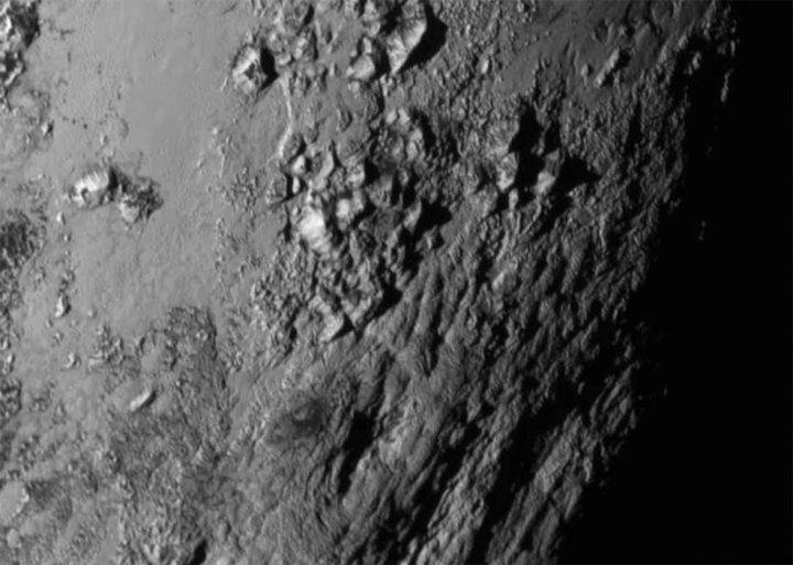 This close-up image of a region near Pluto's equator captured by NASA's New Horizons spacecraft on July 14, 2015 reveals a range of youthful mountains rising as high as 11,000 feet (3.4 kilometers) above the surface of the dwarf planet. This iconic image of the mountains, informally named Norgay Montes (Norgay Mountains) was captured about 1 ½ hours before New Horizons' closest approach to Pluto, when the craft was 47,800 miles (77,000 kilometers) from the surface of the icy body. The image easily resolves structures smaller than a mile across. The highest resolution images of Pluto are still to come, with an intense data downlink phase commencing on Sept. 5, 2015. Credits: NASA-JHUAPL-SwRI