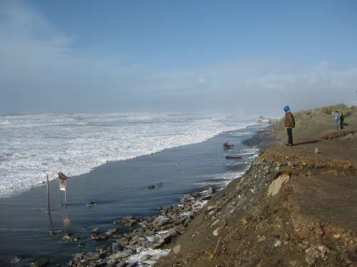 Severe coastal bluff erosion, along the southern end of Ocean Beach, San Francisco, California. This storm damage occurred during the 2009-2010 El Niño, which, on average, eroded the shoreline 55 meters that winter. Image credit: Jeff Hansen/USGS