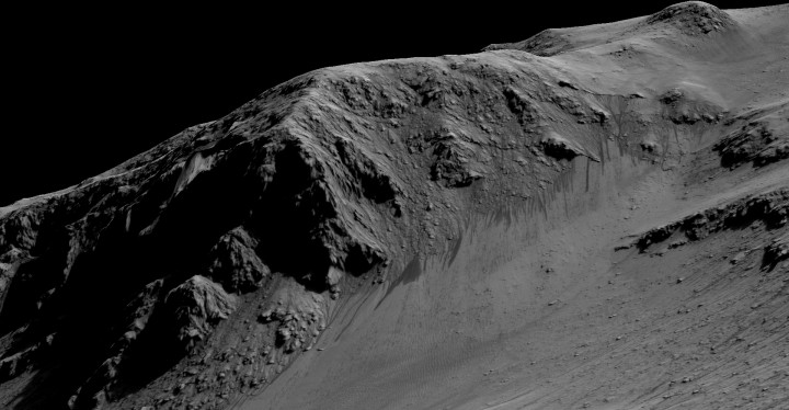 """The dark, narrow streaks flowing downhill on Mars at sites such as this portion of Horowitz Crater are inferred to be formed by seasonal flow of water on modern-day Mars. The streaks are roughly the length of a football field. These dark features on the slopes are called """"recurring slope lineae"""" or RSL. The imaging and topographical information in this processed view come from the High Resolution Imaging Science Experiment (HiRISE) camera on NASA's Mars Reconnaissance Orbiter. Credit: NASA/JPL-Caltech/Univ. of Arizona"""
