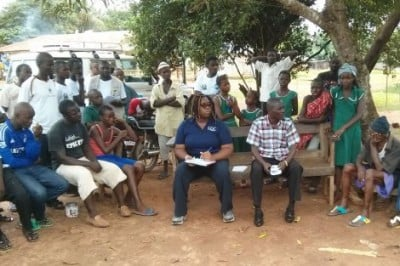Rashon Lane (center front) and social mobilizers in Sierra Leone trained frontline responders of the Ebola outbreak to conduct interviews with community members to better understand the high infant mortality rates in that district. Image credit: Rashon Lane