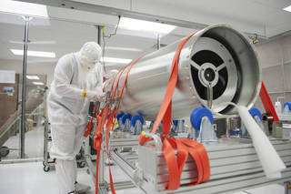 A NASA worker in a clean room at the National Space Science Technology Center in Huntsville, Alabama, checks out the CLASP instrument prior to shipping to White Sands Missile Range in New Mexico for its Sept. 3 launch. Credits: NASA/MSFC