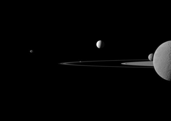 Saturn's moons (from left to right) Janus, Pandora, Enceladus, Mimas and Rhea. Rhea is on top of Saturn. Credit: NASA/JPL-Caltech/Space Science Institute