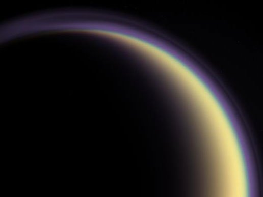 A composite image of Titan's atmosphere, created using blue, green and red spectral filters to create an enhanced-color view. Image Credit: NASA/JPL/Space Science Institute