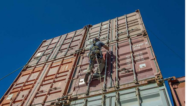 A rigger scales Lawrence Livermore National Laboratory's cargo container stack testbed as part of a radiation detector exercise that involved five laboratories and one private company. Photos by Julie Russell