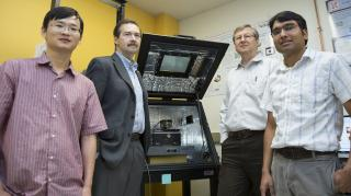 (From left) Haidong Lu, postdoctoral researcher; Alexei Gruverman, professor of physics and astronomy; Evgeny Tsymbal, professor of physics and astronomy; and Tula R. Paudel, research assistant professor. The scientists are affiliated with the Nebraska Center for Materials and Nanoscience. Tsymbal is director of the NSF-supported Materials Research Science and Engineering Center at UNL. Image credit: Troy Fedderson/University Communications