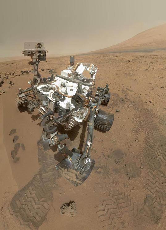 A color self-portrait photo of Curiosity standing on Mars, on sol 84 (October 31, 2012). The photo is a mosaic of images shot with MAHLI, the camera on the end of the robotic arm. Credit: NASA/JPL/MSSS.