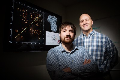 Graduate student Joseph Courtney and chemistry professor Chad Rienstra developed a method to quickly and reliably determine a protein's intricately folded structure. Photo credit: L. Brian Stauffer