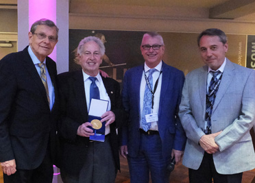 Dr. Jay Boris (second from left), NRL chief scientist for Computational Physics, is presented the Institute for the Dynamics of Explosions and Reactive Systems Numa Manson Medal for distinguished contributions to the dynamics of explosions and reactive systems. Shown from left to right are: Forman Williams, nominator and world's foremost combustion theorist; Jay Boris, chief scientist, U.S. Naval Research Laboratory; Luc Bauwens, IDERS president and professor at University of Calgary; and Sergey Dorofeev, chair, Awards Selection Committee.