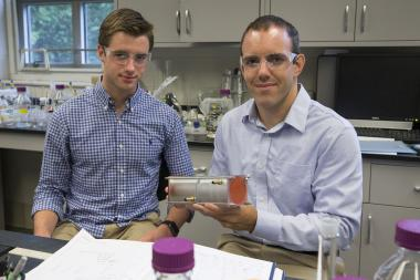 Chemical engineering major Andrew Biedermann (left), a Harrison Undergraduate Research grant recipient, works on polymer membranes with Geoffrey Geise, an assistant professor in the Department of Chemical Engineering. Image credit: Dan Addison
