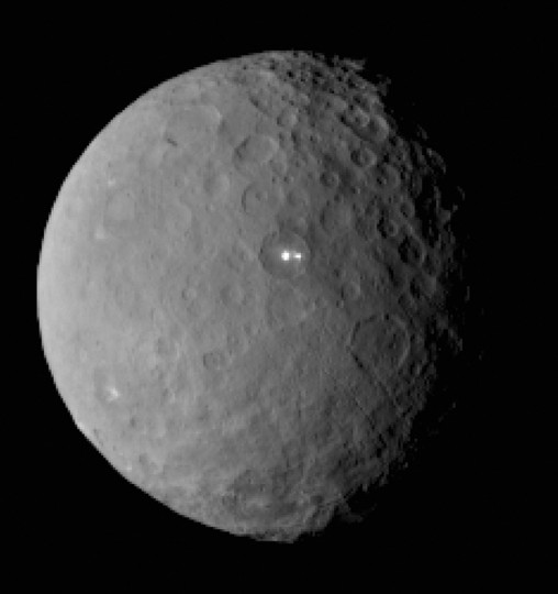 This image was taken by NASA's Dawn spacecraft of dwarf planet Ceres on Feb. 19 from a distance of nearly 29,000 miles (46,000 km). It shows that the brightest spot on Ceres has a dimmer companion, which apparently lies in the same basin. See below for the wide view. Credit: NASA/JPL-Caltech/UCLA/MPS/DLR/IDA