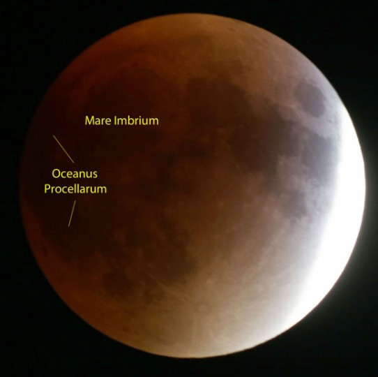 Oceanus Procellarum and Mare Imbrium are large, dark volcanic plains that contributed to the Moon's faintness and dark-hued totality. Credit: Bob King