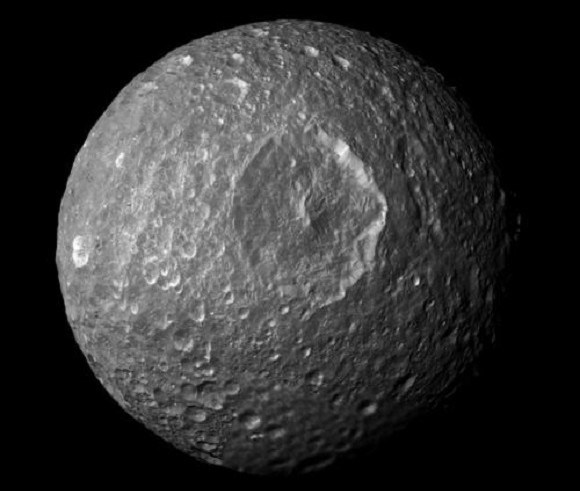 Mosaic image of Mimas, created from images taken by NASA's Cassini spacecraft, showing the Herschel crater in the center. Credit: NASA/JPL