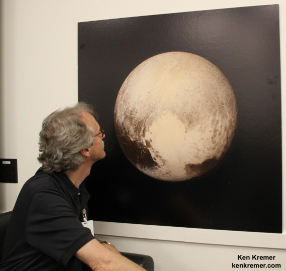 New Horizons science team co-investigator John Spencer examines print of the newest Pluto image taken on July 13, 2015 after the successful Pluto flyby. Credit: Ken Kremer