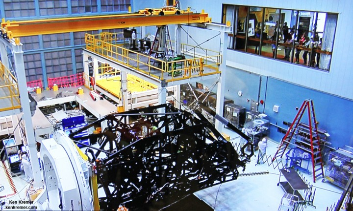 Side view of flight unit mirror backplane assembly structure for NASA's James Webb Space Telescope (JWST) that holds primary mirror array and secondary mirror mount in stowed-for-launch configuration. JWST is being assembled technicians inside the cleanroom at NASA Goddard Space Flight Center, Greenbelt, Md. Credit: Ken Kremer