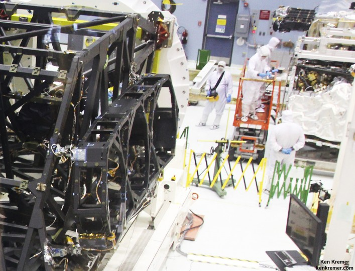 Up close view of actual side wing backplane of NASA's James Webb Space Telescope (JWST) that will hold 3 of the observatory's 18 primary mirrors, as technicians work inside cleanroom at NASA Goddard Space Flight Center, Greenbelt, Md. Credit: Ken Kremer