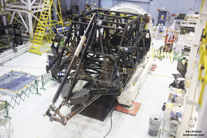 View showing actual flight structure of mirror backplane unit for NASA's James Webb Space Telescope (JWST) that holds 18 segment primary mirror array and secondary mirror mount at front, in stowed-for-launch configuration. JWST is being assembled here by technicians inside the world's largest cleanroom at NASA Goddard Space Flight Center, Greenbelt, Md. Credit: Ken Kremer