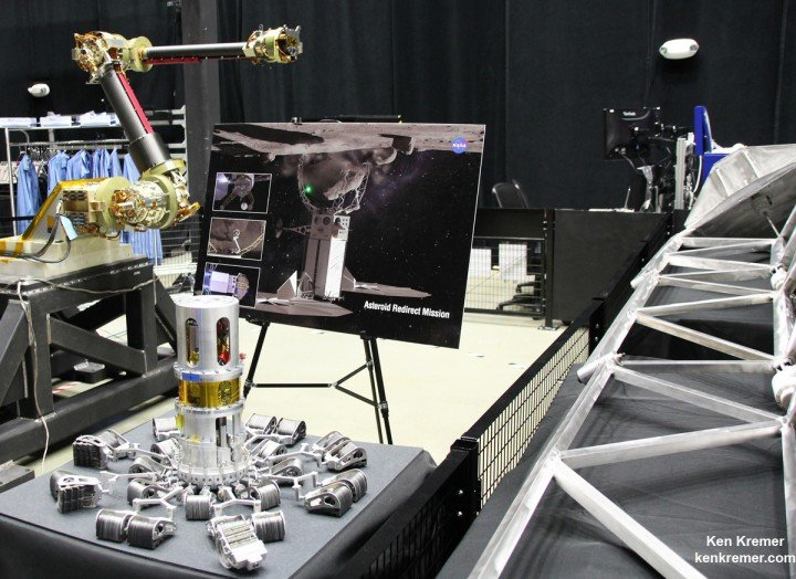 View of the robotic arm above and gripper tool below that initially grabs the asteroid boulder before the capture legs wrap around as planned for NASA's upcoming unmanned ARRM Asteroid Redirect Robotic Mission that will later dock with an Orion crew vehicle. Credit: Ken Kremer