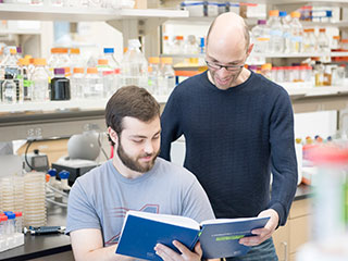 Assembling the factory: Using a new technique they devised, Sebastian Klinge (right), Malik Chaker-Margot (left), and their colleagues examined the components involved in the construction of the small ribosomal subunit, the first half of the ribosome to be put together.