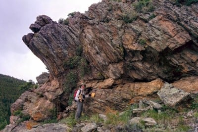 A rock outcrop in Gordon Gulch, Colo., with Stephen Martel of the University of Hawaii pictured in the foreground. Photo credit: Taylor Perron