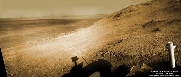 Mosaic view from Opportunity rover looking along the high walls and down the floor of Marathon Valley with deposits of water altered clay minerals and out to the vast expense of Endeavour Crater. This navcam camera photo mosaic was assembled from images taken on Sol 4159 (Oct. 5, 2015) and colorized. Credit: NASA/JPL/Cornell/Marco Di Lorenzo/Ken Kremer