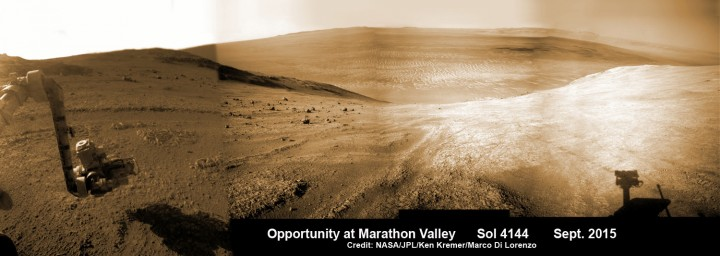 Panoramic view from NASA's Opportunity rover looking down the floor of Marathon Valley and out to the vast expense of Endeavour Crater. Marathon Valley holds significant deposits of water altered clay minerals. This composite photo mosaic shows the rover's robotic arm reaching out at left to investigate Martian rocks holding clues to the planets watery past, and robot shadow and wheel tracks visible at right. The mosaic combines a flattened fisheye hazcam image at left with a trio of navcam camera images taken on Sol 4144 (Sept. 20, 2015) and colorized. Credit: NASA/JPL/Cornell/Ken Kremer/Marco Di Lorenzo