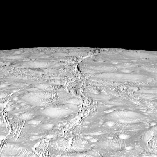 NASA's Cassini spacecraft zoomed by Saturn's icy moon Enceladus on Oct. 14, 2015, capturing this stunning image of the moon's north pole. A companion view from the wide-angle camera (PIA20010) shows a zoomed out view of the same region for context. Image Credit: NASA/JPL-Caltech/Space Science Institute