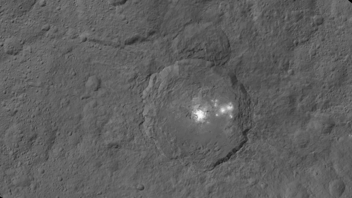 This mosaic shows Ceres' Occator crater and surrounding terrain from an altitude of 915 miles (1,470 kilometers), as seen by NASA's Dawn spacecraft. Occator is about 60 miles (90 kilometers) across and 2 miles (4 kilometers) deep. Image Credit: NASA/JPL-Caltech/UCLA/MPS/DLR/IDA