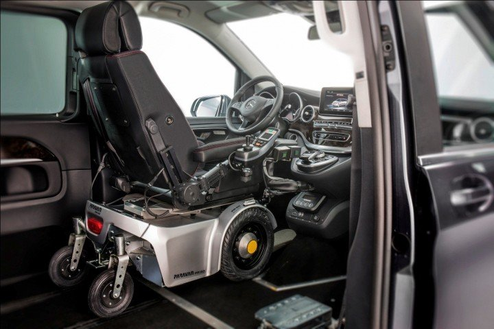 With Paravan conversions and docking station, disabled person can drive the vehicle from their electronic wheelchair. Image credit: media.daimler.com.