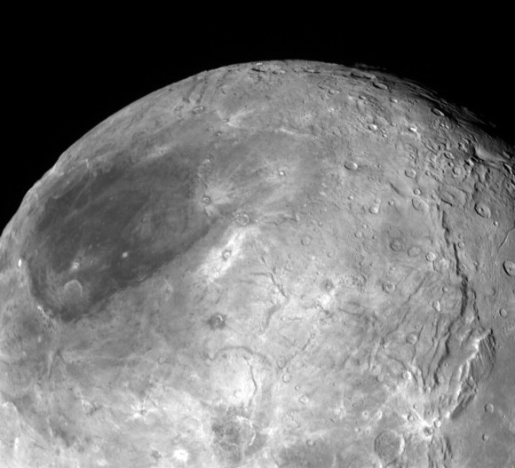 Looking over Charon's dark north polar region, the border of which is highlighted by several beautiful rayed craters. Not that it's necessarily related, but the dark spot reminds me of a lunar mare or sea. On the moon, cracks in the crust allowed lava to fill gigantic basins to create the maria. Could material from beneath Charon have bubbled up to fill an ancient impact? Credit: NASA/JHUAPL/SwRI