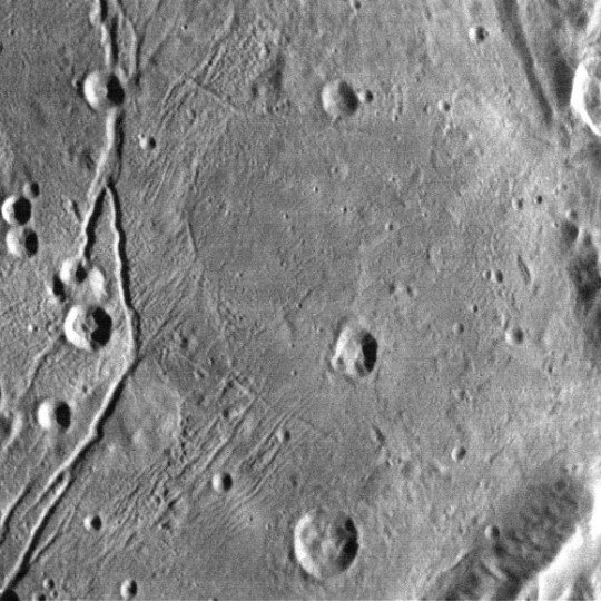 Speaking of the Moon, the large cracks at left resemble lunar rills, some of which formed through faulting / fracturing and others as conduits for lava flows. The multiple, fine cracks  are interesting. Credit: NASA/JHUAPL/SwRI