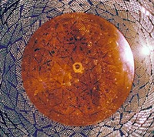 An interior view, looking up from the bottom, of one of SNO's nearly 10,000 ultra-sensitive photomultiplier tubes that form a snakeskin-looking sheath around the detector's geodesic sphere.