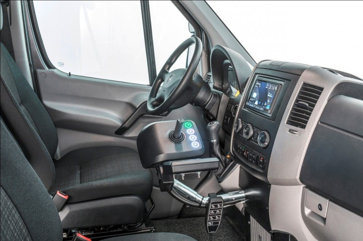 Simple hand controls allow for precise, safe and easy operation. Pedals remain operational, in case someone else needs to use the vehicle, but can be covered to prevent unintentional operation. Image credit: media.daimler.com.