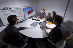 The W80-4 mechanical team at Sandia National Laboratories reviews the results of thermal analysis. From the top center, counterclockwise, are Ryan Johnson, Bryn Miyahara, Alvin Leung and Matt H. Jones. (Photo by Randy Wong) Click on the thumbnail for a high-resolution image.