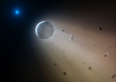 An artist's impression of a rocky planet disintegrating around a white dwarf star. Image credit: Mark A. Garlick