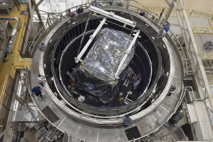 This rare overhead view of the thermal vacuum chamber at NASA's Goddard Space Flight Center in Greenbelt, Maryland shows engineers readying the Integrate Science Instrument Module (ISIM) that was just lowered into the chamber for its final cryogenic test at Goddard. Credits: NASA/Chris Gunn